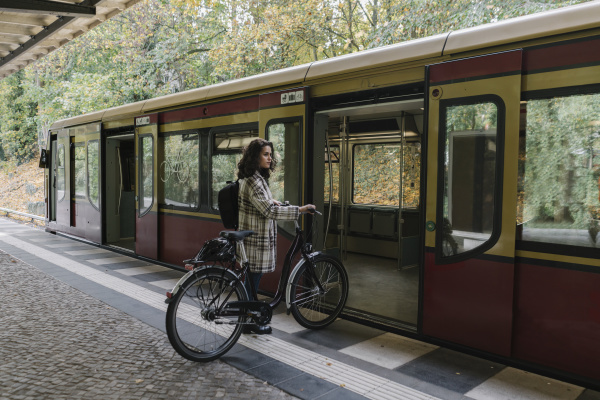 woman, with, bicycle, entering, an, underground - 28018595