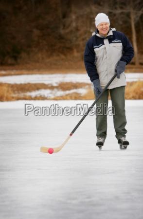 man playing shinny hockey