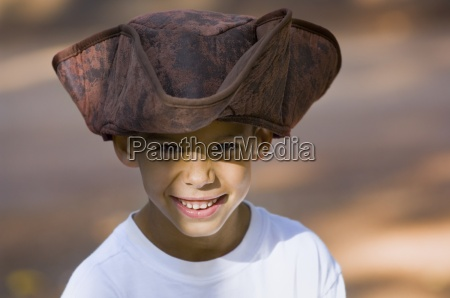 young boy wearing a pirate hat