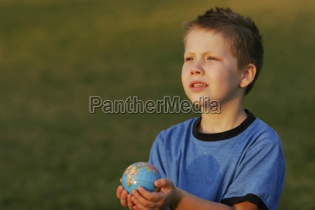 boy holding a globe in his