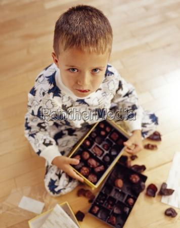 boy into box of chocolates