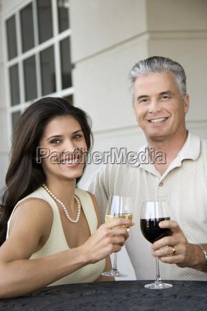 smiling couple drinking wine