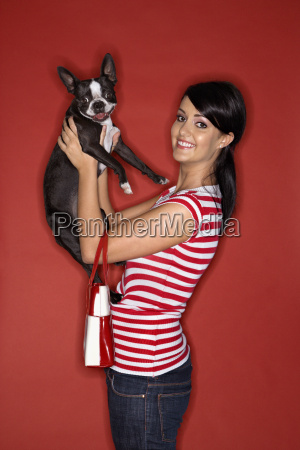 woman holding boston terrier dog