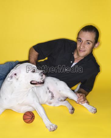man with white dog