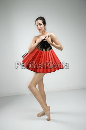 nude woman with fan