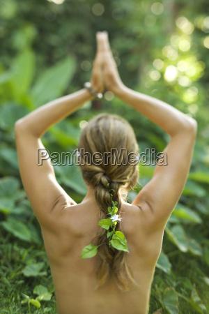 nude woman practicing yoga