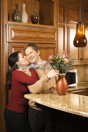 happy couple in kitchen