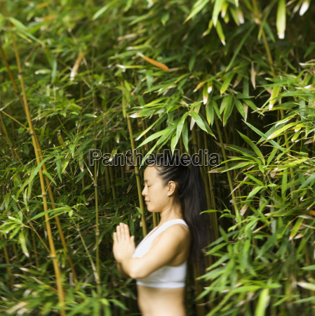 asian woman meditating