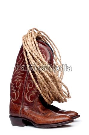 pionowy obraz pare brazowych kowbojskie buty