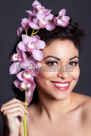 pretty woman with orchid flower