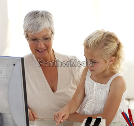little girl explaining her grandmother how