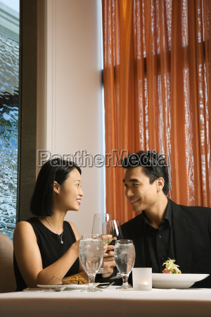 attractive young couple smiling at each