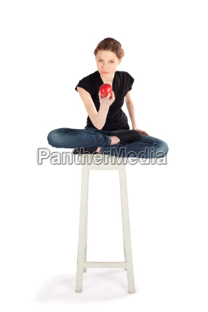 young slim woman sitting on stool