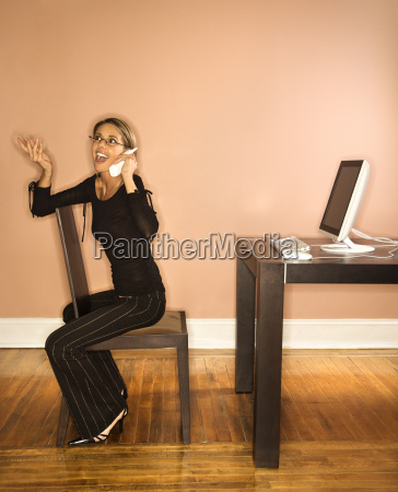 attractive young businesswoman talking on phone