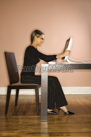 attractive young businesswoman looking at computer