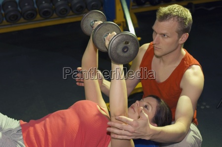 two people working out with weights