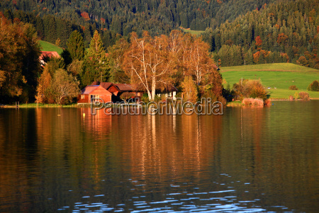 reflection wieczorne slonce suesswasser jezioro inland