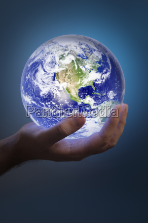 man holding a glowing earth in