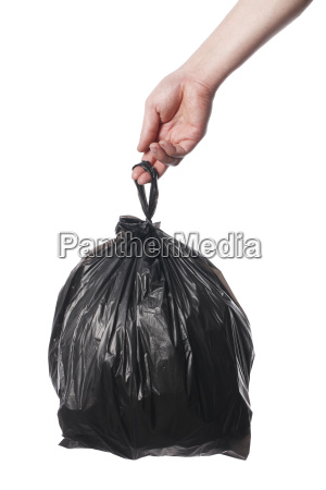 man holding black plastic trash bag