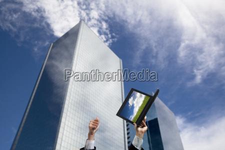 businessman hand raised computer and thumb