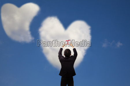 man holding gift and two heart
