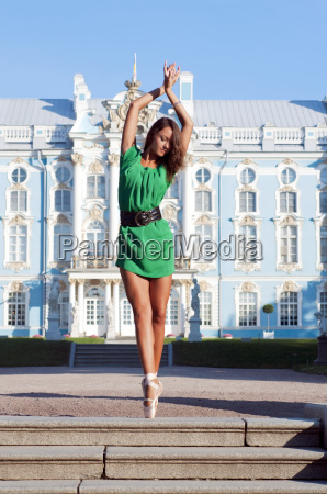 ballerina is dancing near the palace