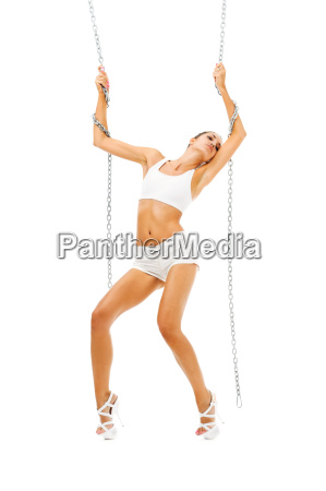 beautiful woman is dancing with chain
