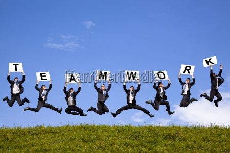 happy businessman holding teamwork text and