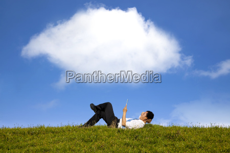 cloud background and happy businessman working
