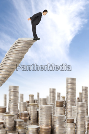surprised businessman standing on the money