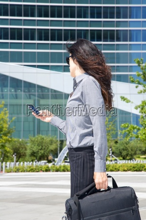 businesswoman with smartphone on hand