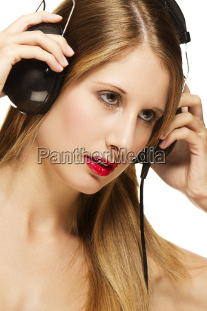 young woman wearing headphones listening to