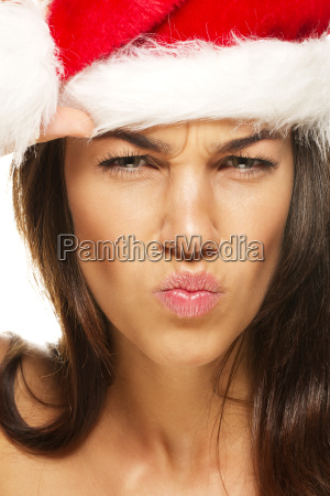 young woman with santa claus hat