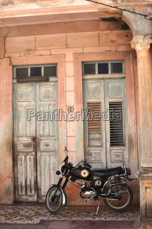 house with motorcycle in the east