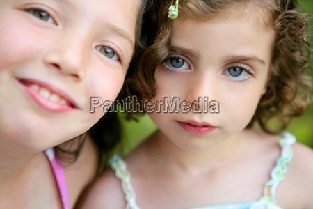 closeup portrait of two little girl