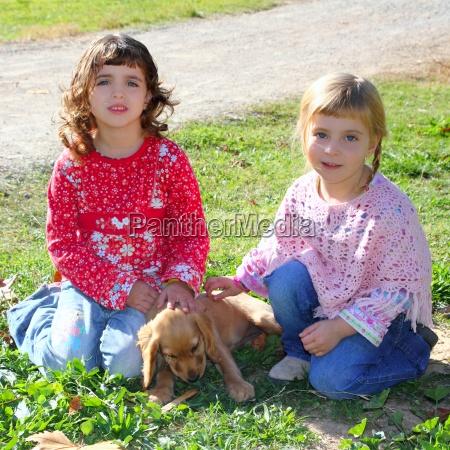 two little girls sister friends golden