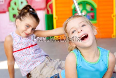 children happy little sister girls playing
