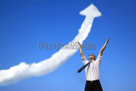 success businessman with business growing graph