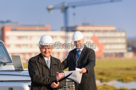 architect man make notes on construction