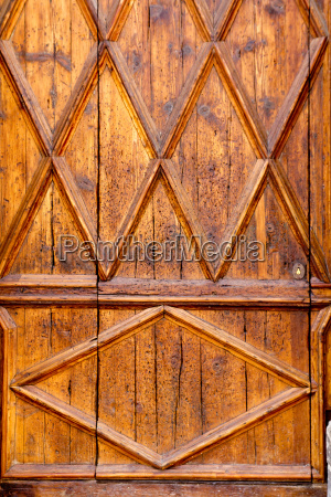 aged golden wood door from lonja