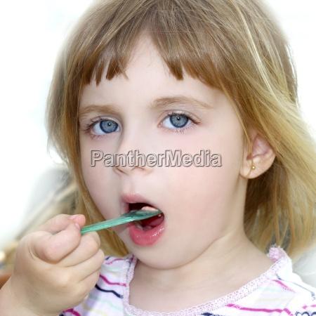 blond little girl eating ice cream