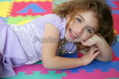beautiful princess little girl smiling lying