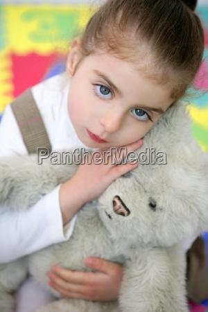 beautiful little girl hug teddy bear
