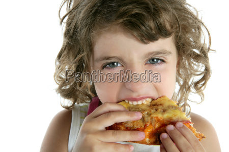 little girl eating hungry pizza closeup