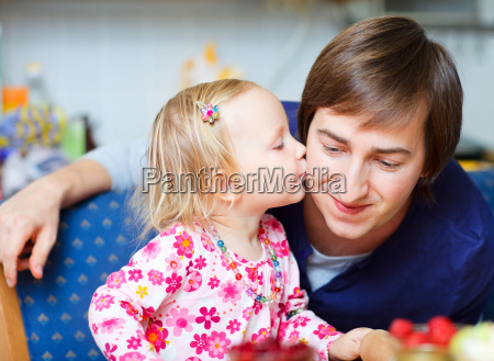 adorable little girl kissing her father