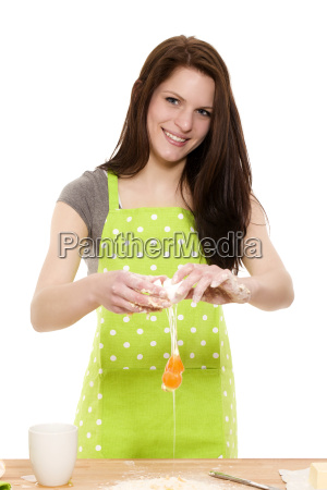 young woman kicks egg on