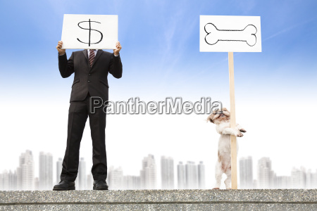 businessman showing the money sign and