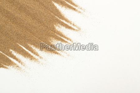 zblizenie piasku na bialym do uzytku