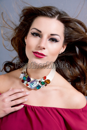 attractive young brunette woman with glamorous