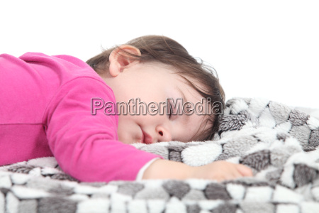 baby sover pa et taeppe